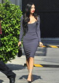 Megan Fox looks stunning in a dark grey bodycon dress as she arrives at 'Jimmy Kimmel Live!' in Hollywood, California
