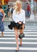 Nicky Hilton braves the wind in a black pleated mini skirt while out in SoHo, New York City