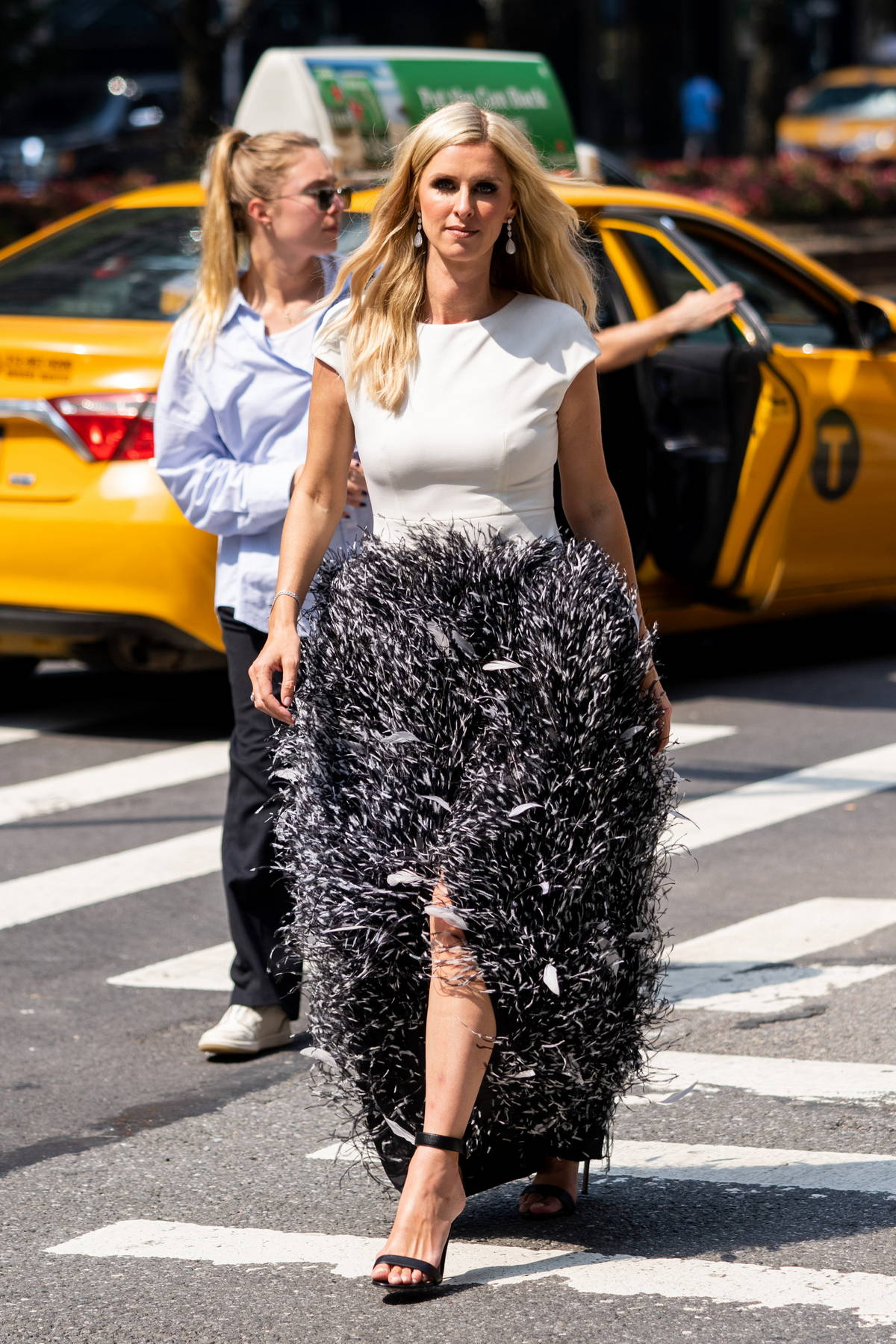 Nicky Hilton looks fashionable in feather skirt on the set of a photoshoot for Avenue Magazine in New York City
