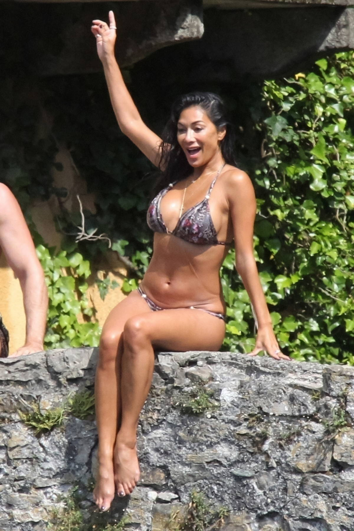Nicole Scherzinger spotted in a bikini while jumping off a bridge during her vacation in Italy