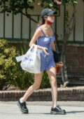 Olivia Rodrigo looks cute in a blue button-up dress while making a coffee run in Los Angeles