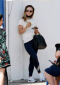 Olivia Wilde keeps it casual with a tee and leggings while she grabs a coffee and food to go in Los Angeles
