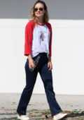 Olivia Wilde wears a red and white full-sleeve top and blue pants while stepping out in Los Angeles
