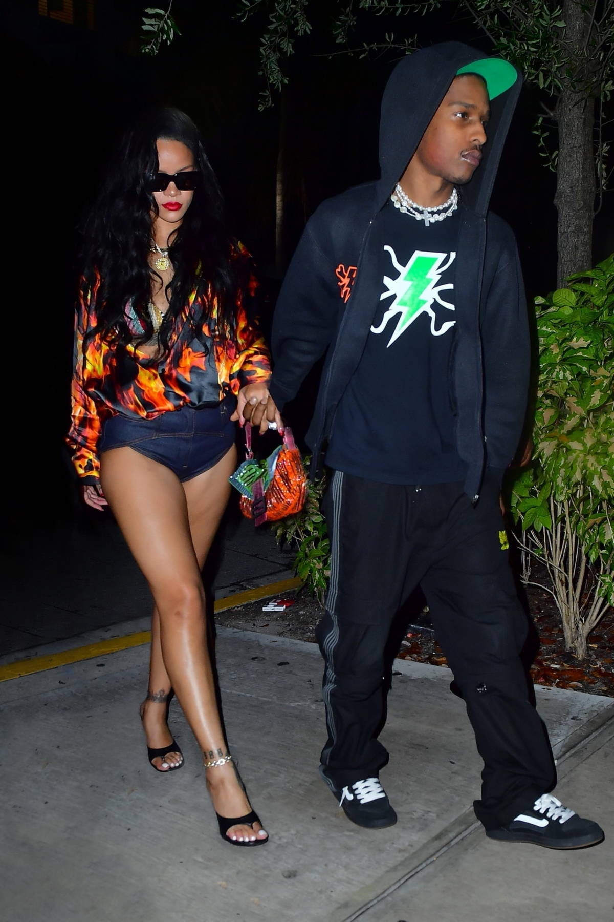 Rihanna and A$AP Rocky go hand in hand during a date night in Miami, Florida