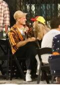 Rita Ora looks smitten as she grabs drinks with boyfriend Taika Waititi out in Los Angeles