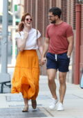 Rose Leslie and Kit Harington are all smiles holding hands during a romantic walk around Manhattan's downtown, New York
