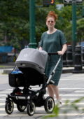 Rose Leslie is all smiles as she steps out on a stroll with her baby boy in New York City