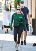 Sofia Richie rocks a sweatshirt and leggings while visiting a hair salon with boyfriend Eliot Grainge in Beverly Hills, California