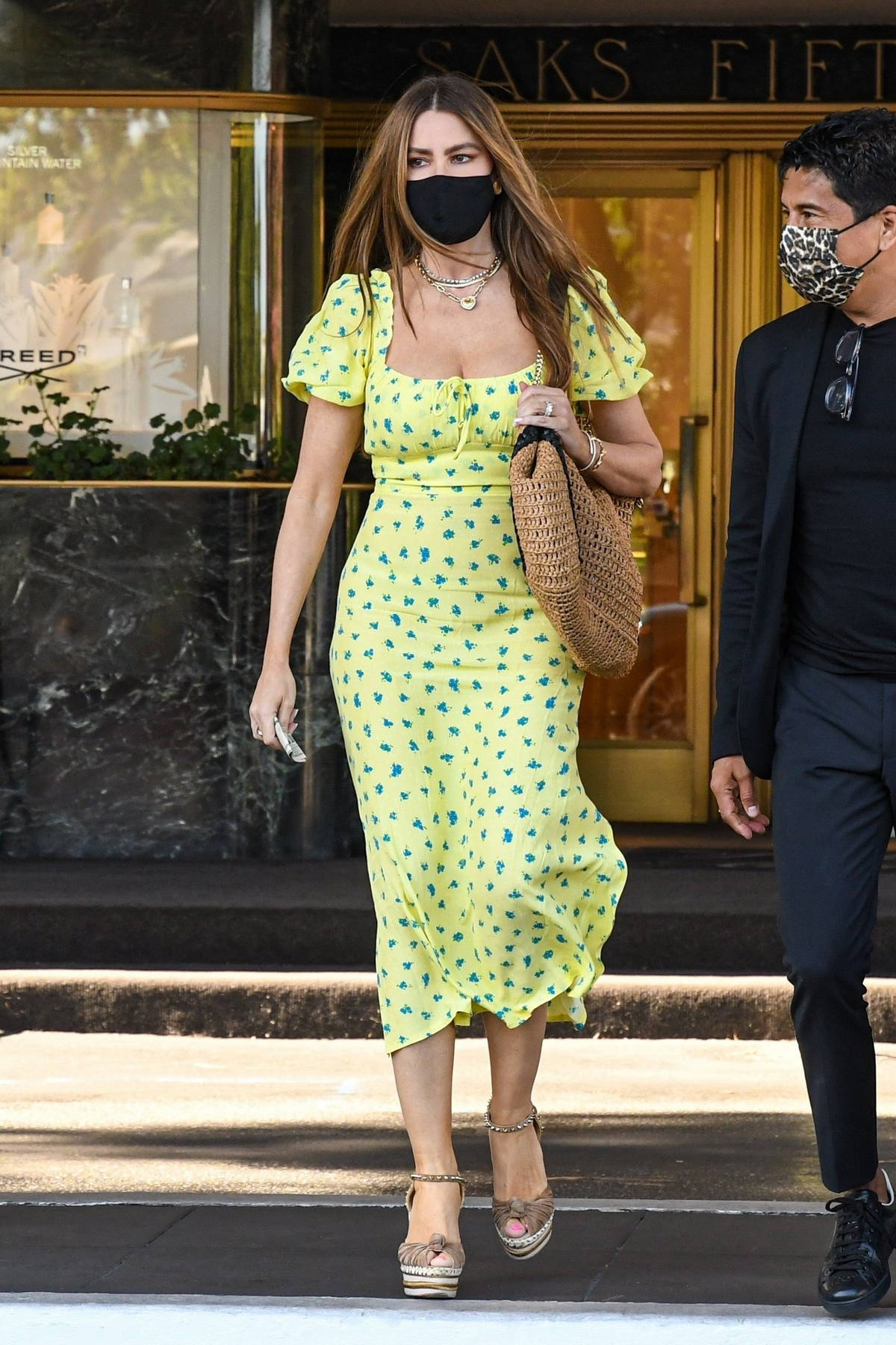 Sofia Vergara looks radiant in a yellow dress during a shopping trip to the Saks Fifth Avenue in Beverly Hills, California
