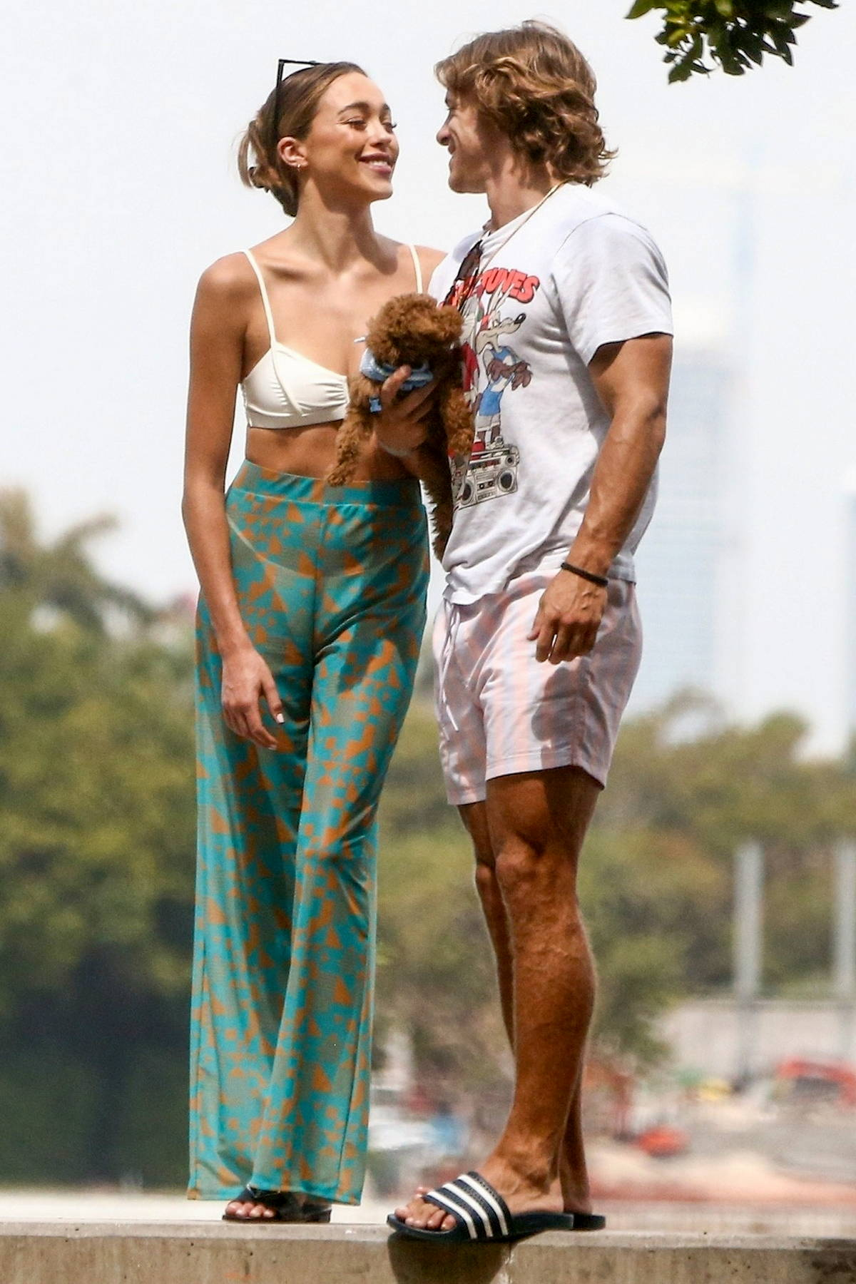 Sophia Culpo and boyfriend Braxton Berrios pose with their pup for a cute photoshoot in Miami Beach, Florida