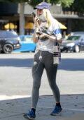 Suki Waterhouse sports grey leggings and white tee as she steps in Beverly Hills, California