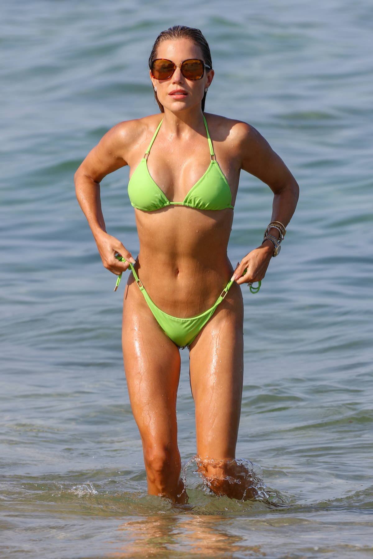 Sylvie Meis sizzles in a green bikini while enjoying another beach day with husband Niclas Castello in Saint-Tropez, France
