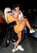 Tana Mongeau gets a little cheeky as lifts her leg while posing with Bryce Hall during a night out in Los Angeles
