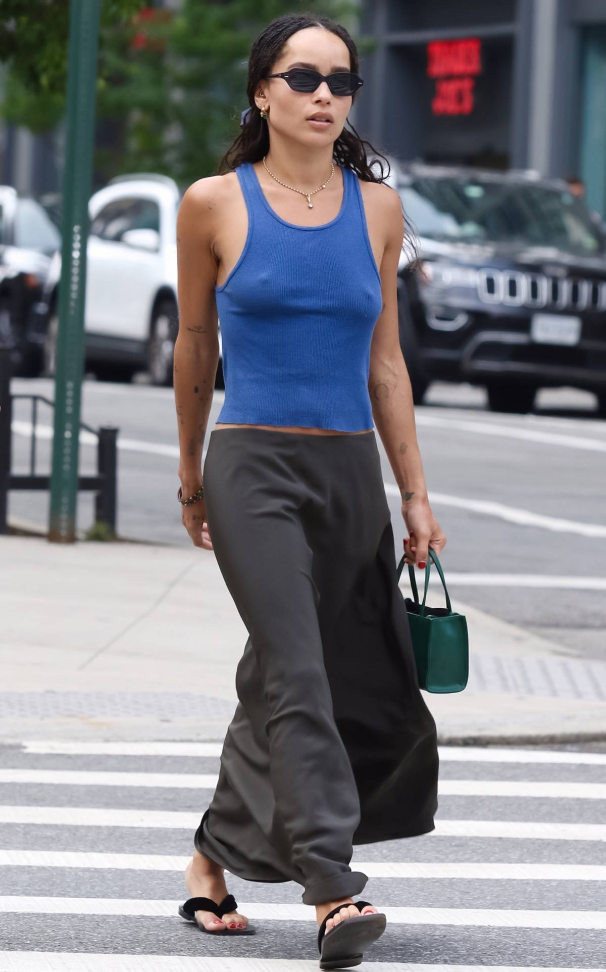 Zoe Kravitz wears a blue tank top and black long skirt as she steps out for lunch in New York City