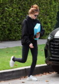 Zoey Deutch sports a black hoodie and leggings as she leaves a Pilates class in West Hollywood, California