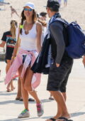 Alessandra Ambrosio and boyfriend Richard Lee hold hands as they visit with friends at AVP in Manhattan Beach, California