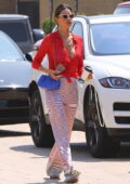 Alessandra Ambrosio looks flawless in a red blouse and patterned trousers as she leaves the Little Beach House in Malibu, California