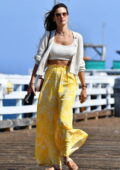 Alessandra Ambrosio looks radiant in a knitted crop top and yellow wide flared pants during a lunch outing in Malibu, California