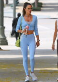Alessandra Ambrosio displays her svelte figure in baby blue top and leggings as she hits a Pilates class in Los Angeles