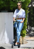 Alessandra Ambrosio sports a cropped sweatshirt and leggings while riding a scooter to a yoga class in Brentwood, California