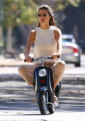 Alessandra Ambrosio takes her son's mini electric scooter out for a test drive in Brentwood, California