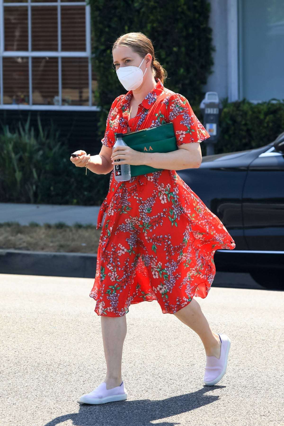 Amy Adams looks lovely in a red floral print dress and pink sneakers while out running errands in Beverly Hills, California