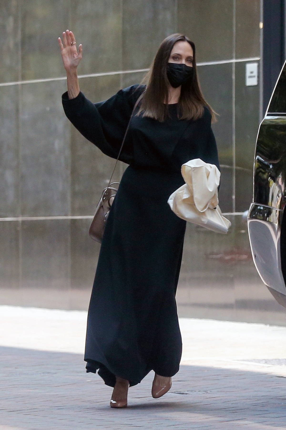 Angelina Jolie looks classy in a black dress as she leaves an office building in Beverly Hills, California