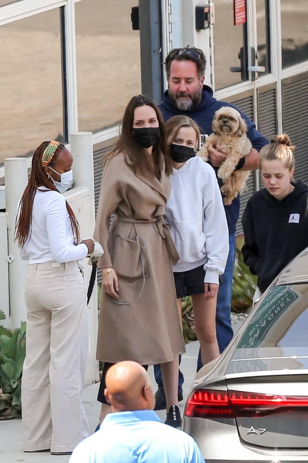 Angelina Jolie seen hugging her kids as she leaves an hospital in Burbank, California