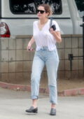 Ashley Benson keeps it casual in a distressed white t-shirt and jeans during a coffee run with a friend in Los Feliz, California