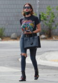 Ashley Benson rocks a vintage Foghat tee with ripped jeans and Gucci boots while out in Los Feliz, California