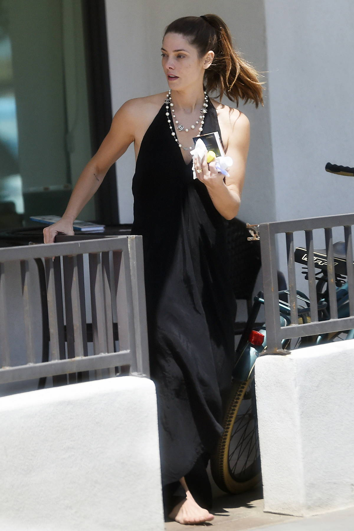 Ashley Greene wears a flowing black dress while out for stroll barefoot with husband Paul Khoury in Newport Beach, California