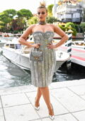 Bebe Rexha dazzles in a metallic dress while attending the Dolce & Gabbana fashion show in Venice, Italy