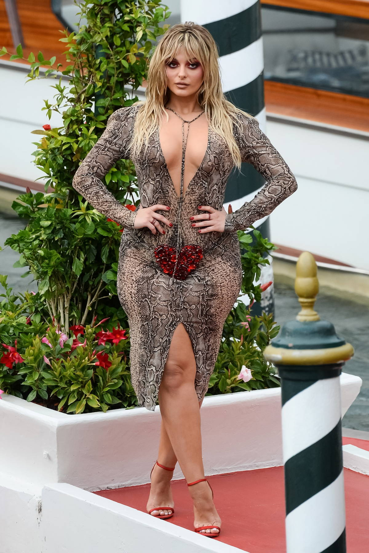Bebe Rexha flaunts her curves in a snake print bodycon dress during the Day 3 of Dolce & Gabbana event in Venice, Italy