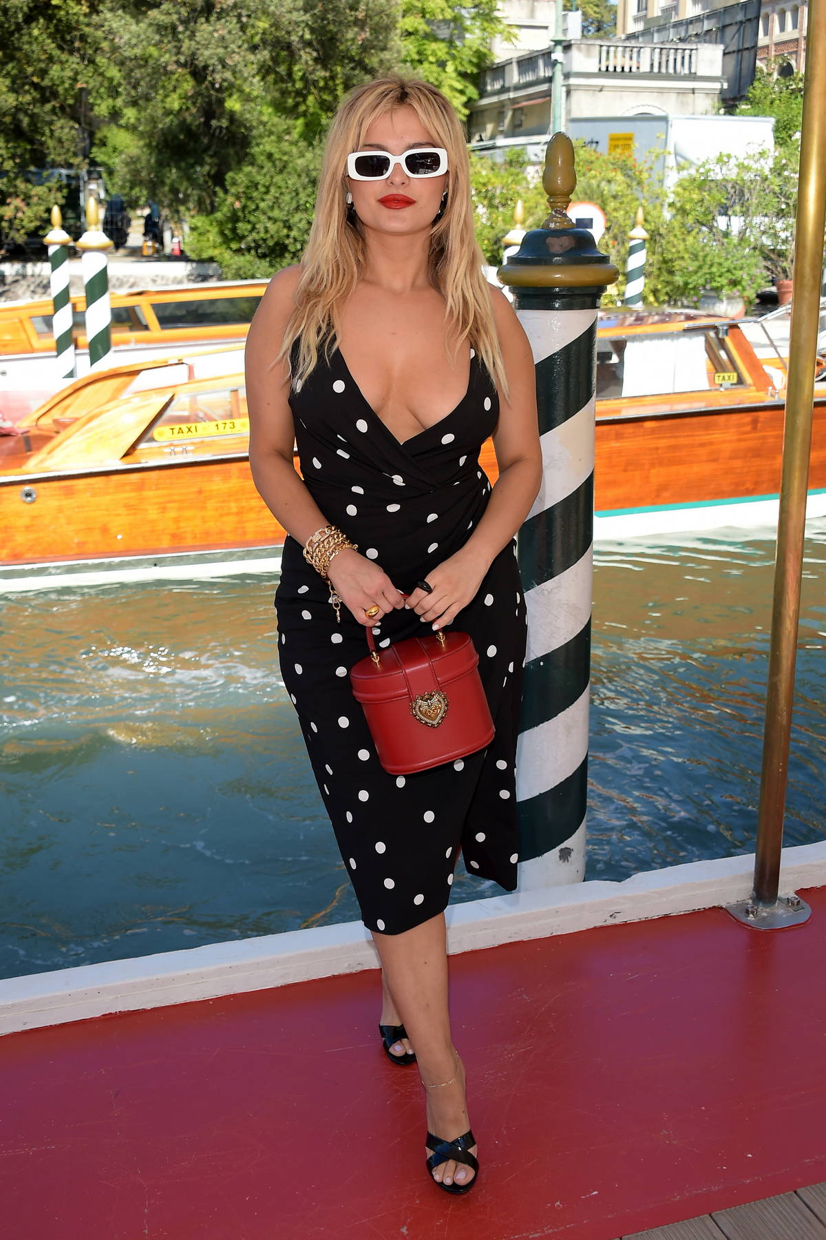 Bebe Rexha looks gorgeous in a plunging polka dot dress while attending the Dolce & Gabbana event in Venice, Italy