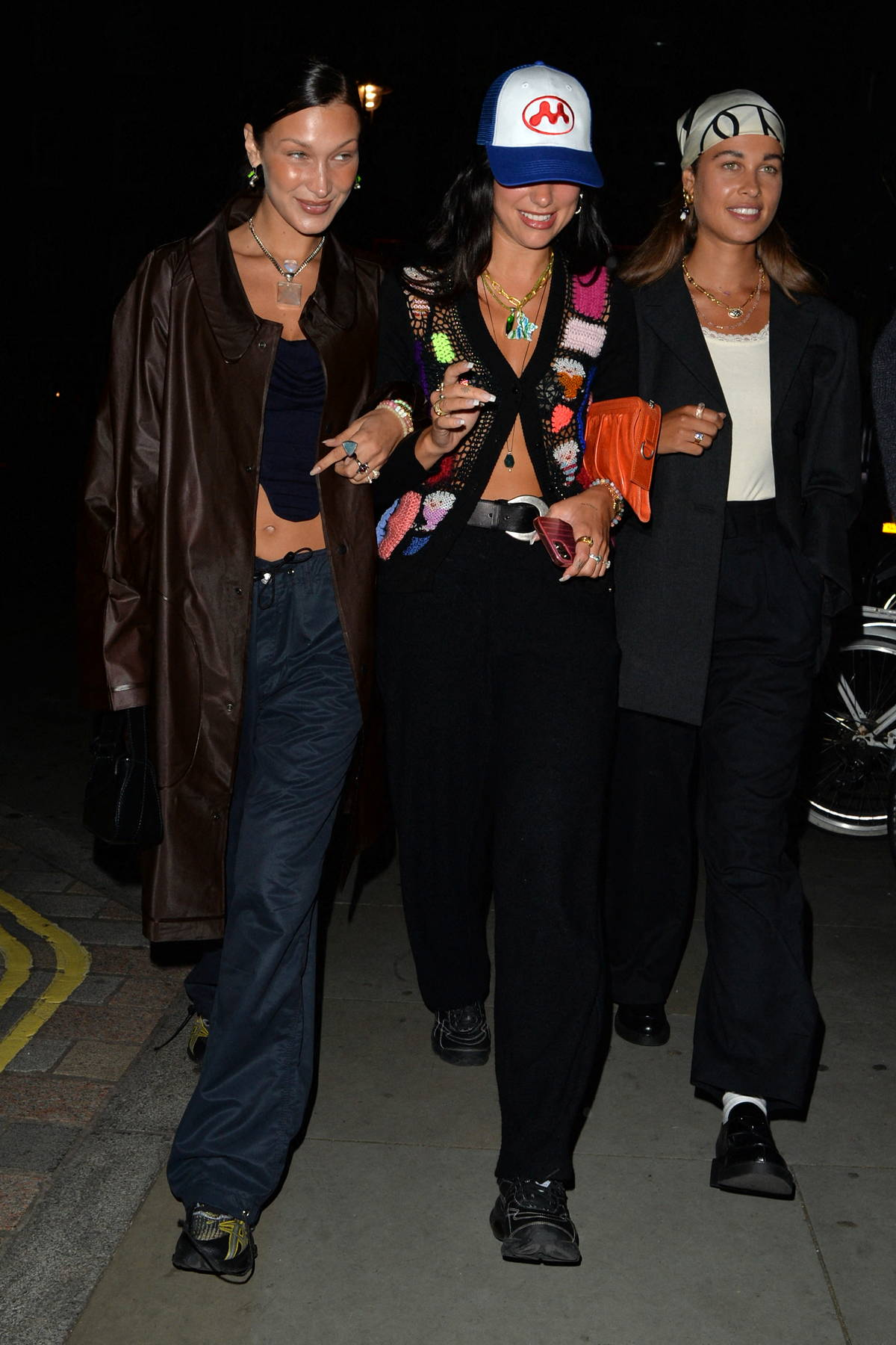 Bella Hadid and Dua Lipa are all smiles as they step out for a girls night out in London, UK