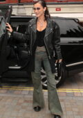 Bella Hadid looks stylish in a black leather jacket and flared jeans while stepping out in London, UK