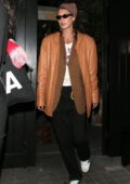 Bella Hadid rocks a mustard leather jacket and black trousers during a shopping trip at Selfridges in London, UK