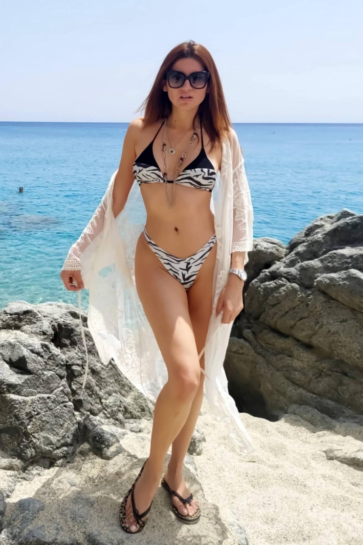 Blanca Blanco slips into a zebra print bikini as she hits the beach in Italy