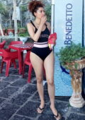 Blanca Blanco wears a black swimsuit while enjoying another day while on vacation in Sicily, Italy