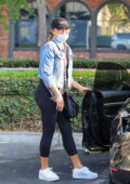 Chrissy Teigen rocks a denim jacket and leggings while stocking up on groceries at Bristol Farms in Los Angeles