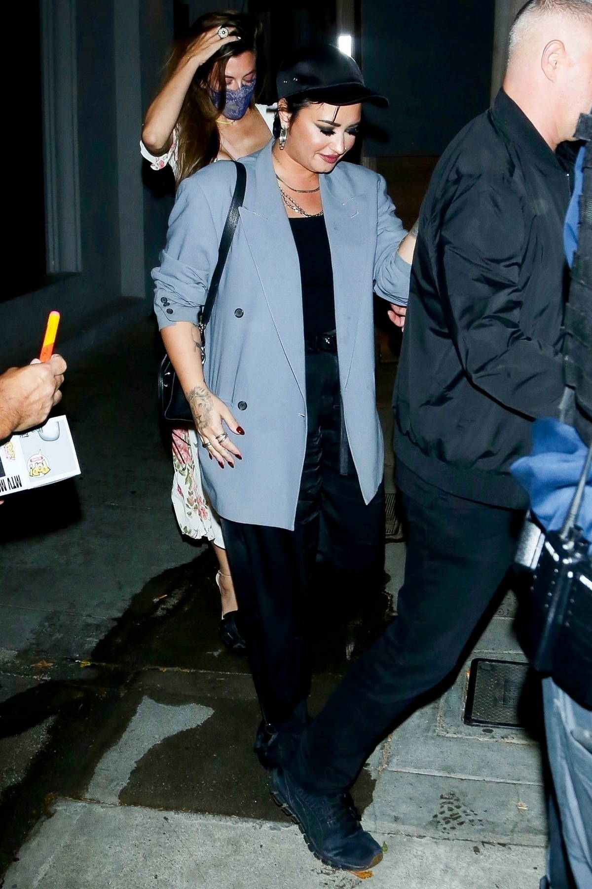Demi Lovato attempts to escape the paparazzi as they leave dinner at Craig's in West Hollywood, California