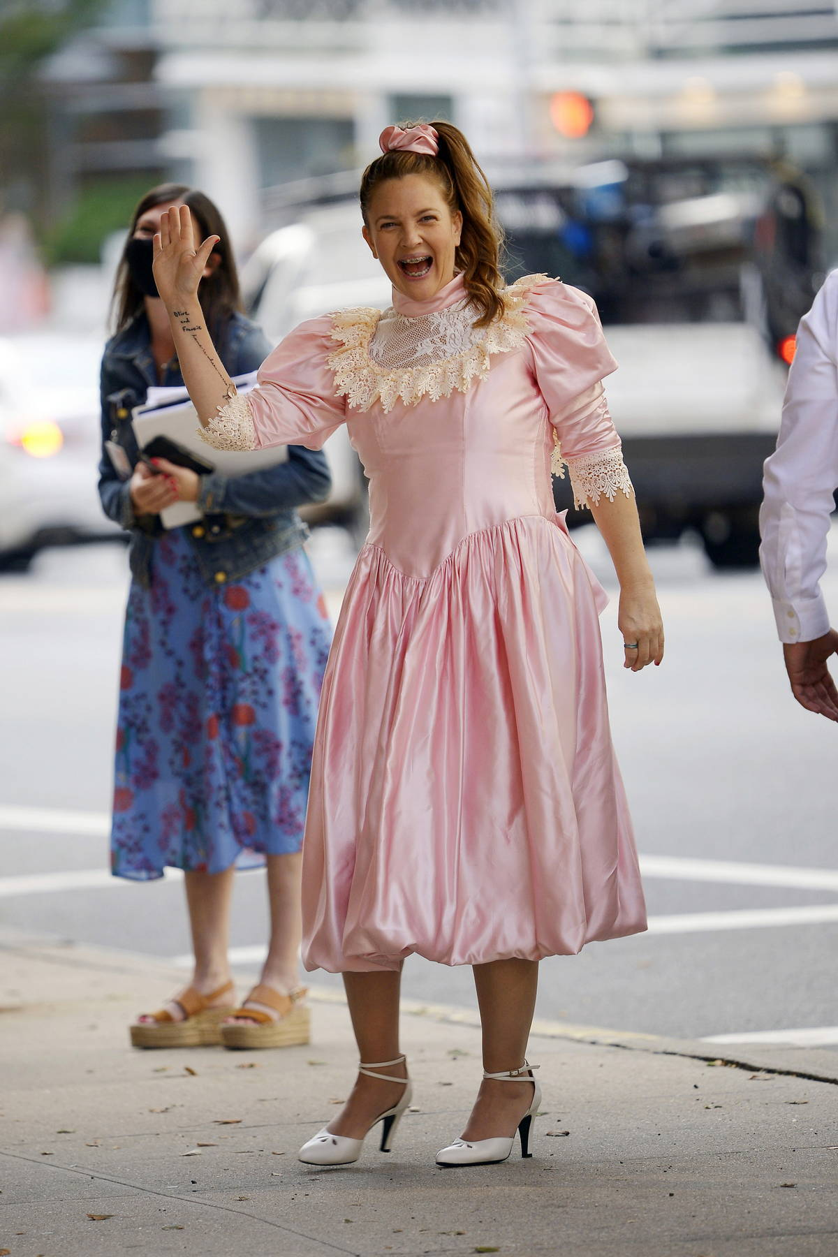 Drew Barrymore seen wearing a Cinderella dress and metal braces while filming an unknown project in New York