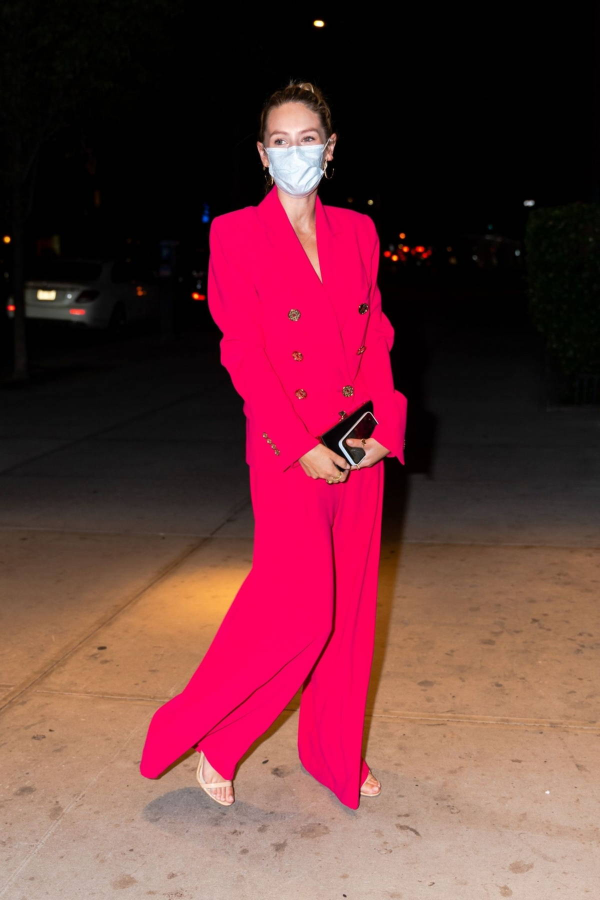Dylan Penn looks striking in a hot pink suit as she steps out with her father Sean Penn in Tribeca, New York City