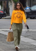 Eiza Gonzalez stands out in bright yellow sweatshirt while she picks up lunch at Joan's on Third in Los Angeles