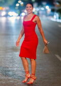 Gina Rodriguez dazzles in a red dress while filming for 'Players' in New York City