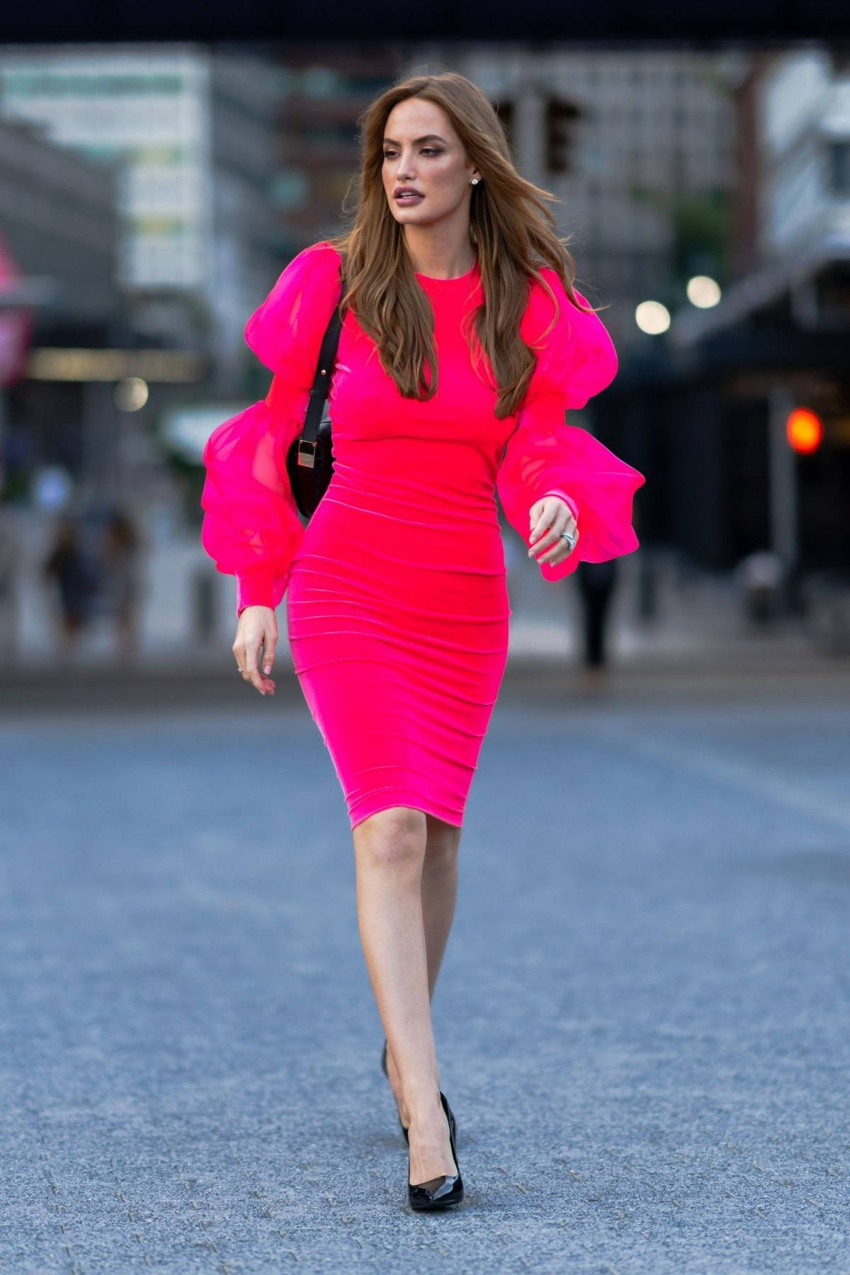 Haley Kalil dazzles in a hot pink dress while stepping out in the South Street Seaport, New York City