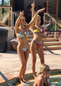 Haley Kalil slips into a colorful bikini while hanging out by the pool with friends at the Elia beach club in Las Vegas, Nevada
