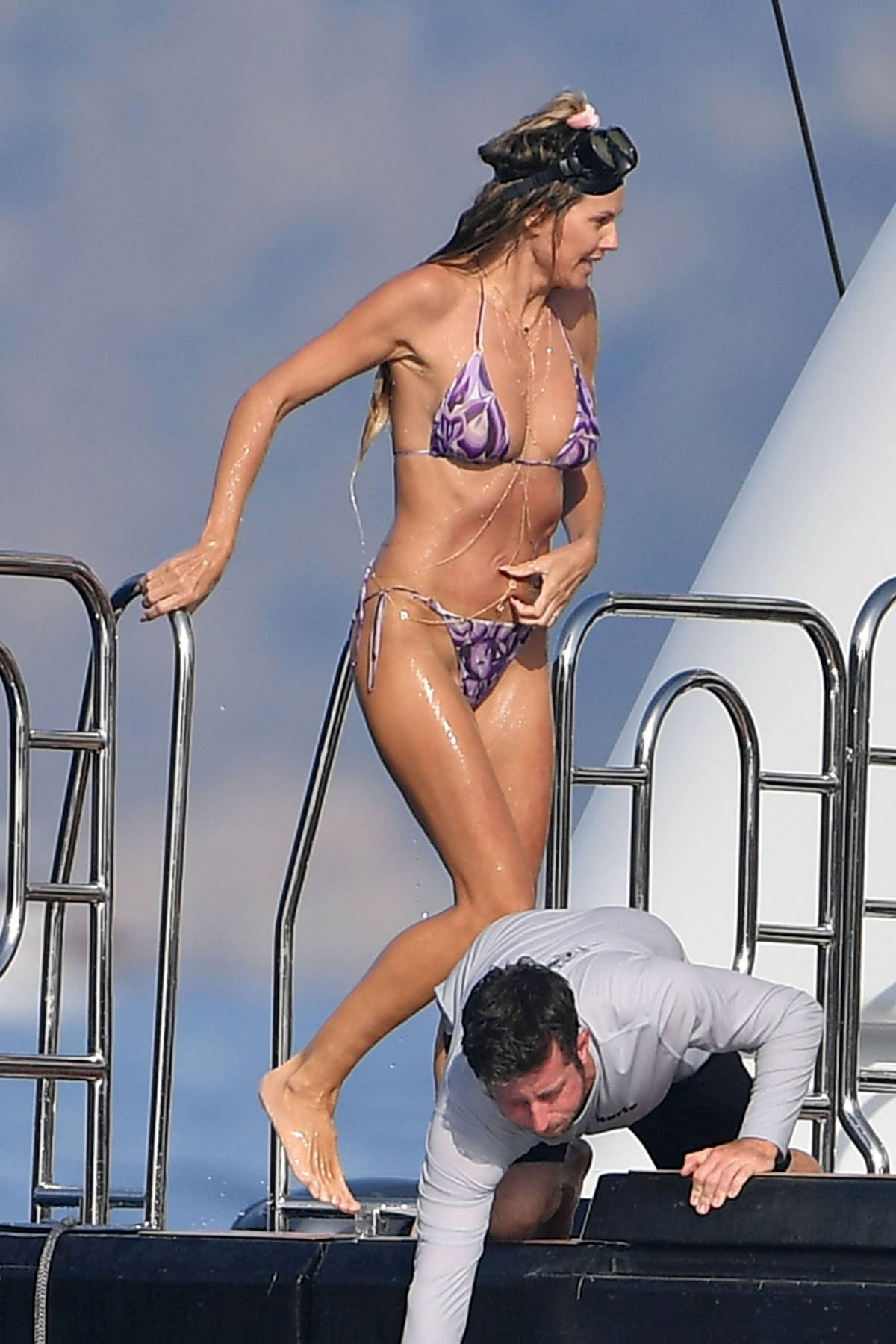 Heidi Klum dons a purple bikini while packing on the PDA with husband Tom Kaulitz during their holiday in Italy