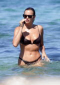 Irina Shayk looks incredible in a brown bikini as she enjoys a beach day with friends in Ibiza, Spain