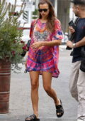 Irina Shayk puts on a colorful display in a short tie-dye dress as she meets a friend for lunch in Los Angeles